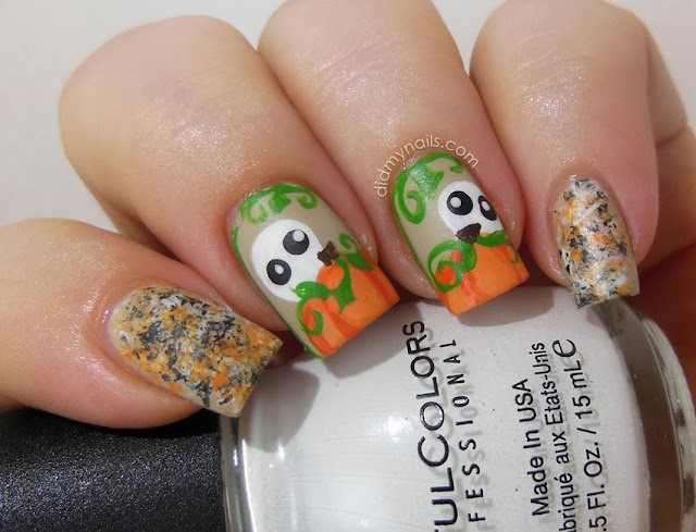 Halloween nail art with pumpkins and ghosts