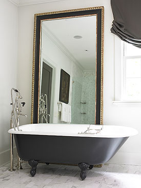 To da loos: Vintage black painted ball-and-claw foot bathtubs
