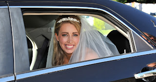 Bride sitting in her wedding car before the ceremony