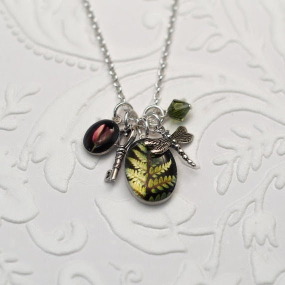 http://www.junehunter.com/collections/botanical-jewelry/products/secret-garden-charm-pendant-botanical-jewelry