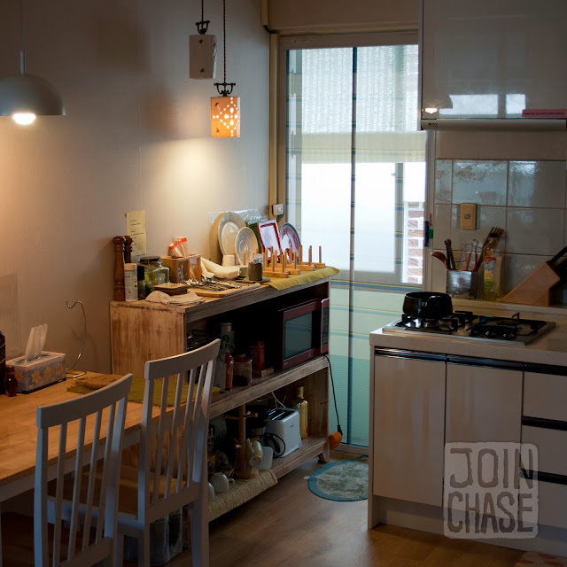 A kitchen and small table in Pedro's House in Gwangju, South Korea.