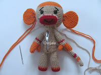 orange and beige sock monkey with zipper