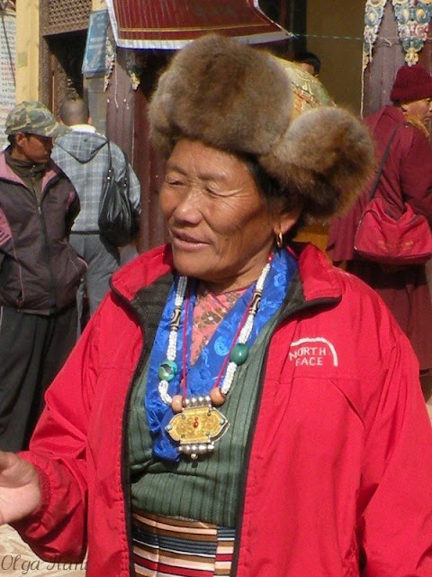 Tibetan woman wearing pearl turquoise coral and dzi beads necklace and amulet container
