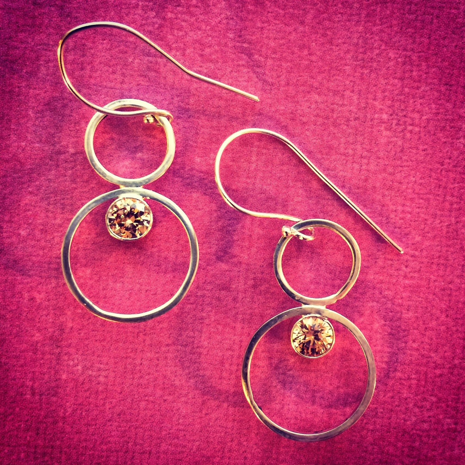 Tube set silver circle earrings with champaign czs set in them