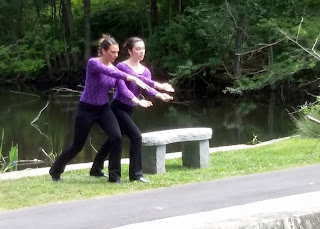 dancers by the 'imagine' bench
