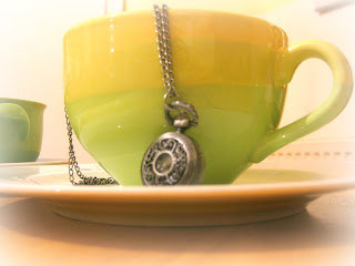 Tea cup with a time piece on it