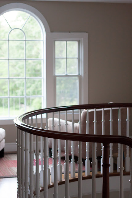 curved banister and arched window