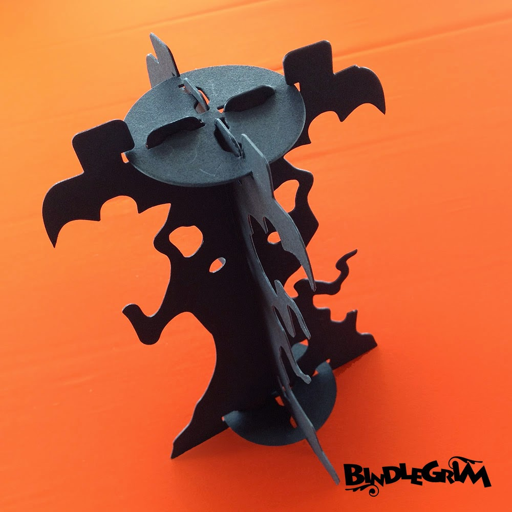 One view of the variety of branches that festoon the silhouette of this candlestick base, part of the Spooklights by Bindlegrim