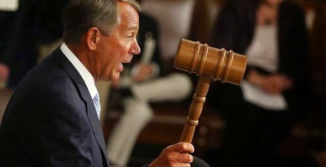 Boehner holding a gavel, striking after the gop led house repeals obamacare