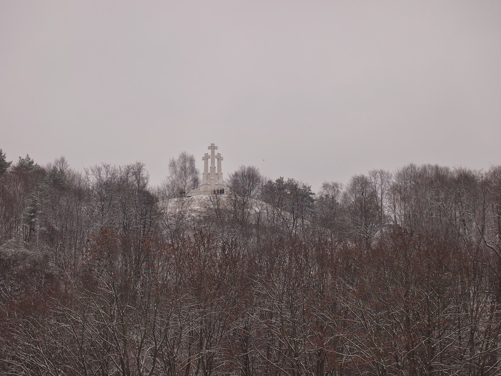 a snow covered hill of three crosses in Vilnius