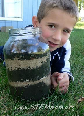 Boy holding newly-made worm jar: STEMmom.org