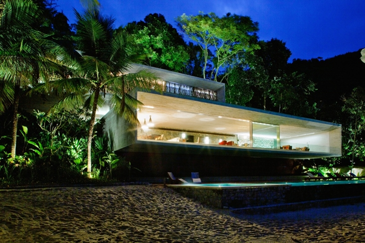 Modern beach house in Brazil by Marcio Kogan at night