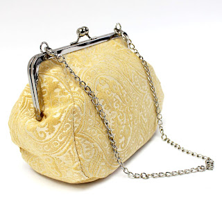 Clutch purse in pale yellow damask