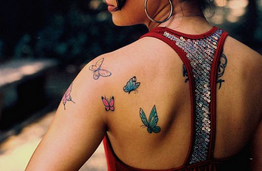 back tattoos for girls. small upper ack tattoos for