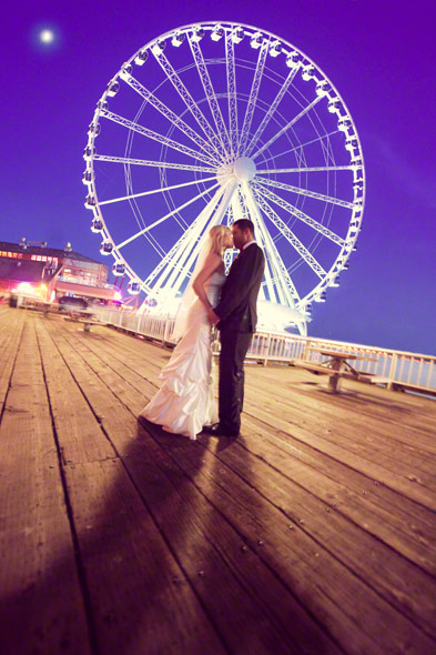 couple kissing after sunset at the great wheel seattle, ferris wheel seattle wedding photos
