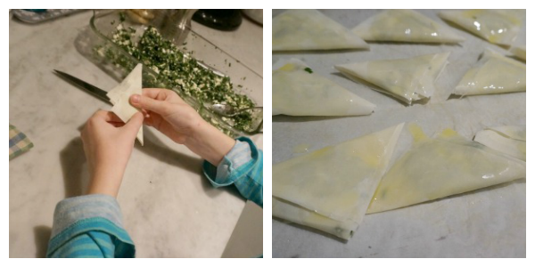 child folding spanakopita
