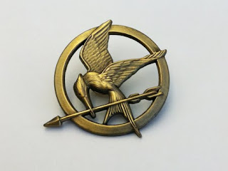 I wish there were stills of the Mockingjay rebel uniform online, but I guess pre-production hasn't quite started yet.