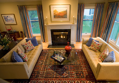 classic living room includes large patterned carpet, fireplace