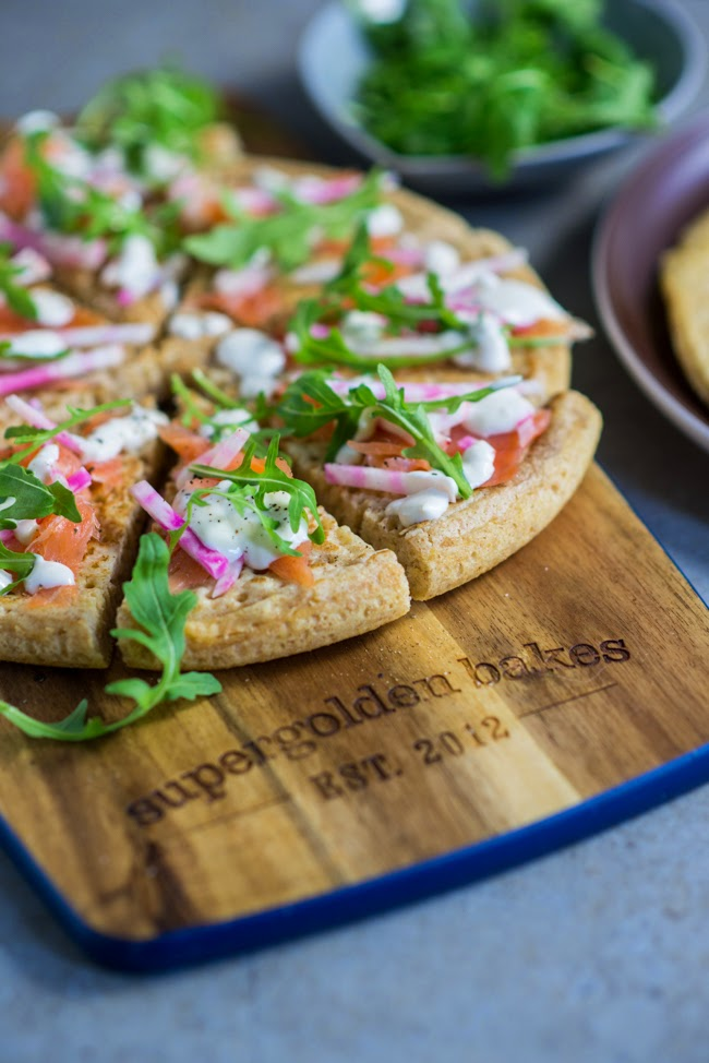 Festive nibbles: blini 'pizza' with smoked salmon