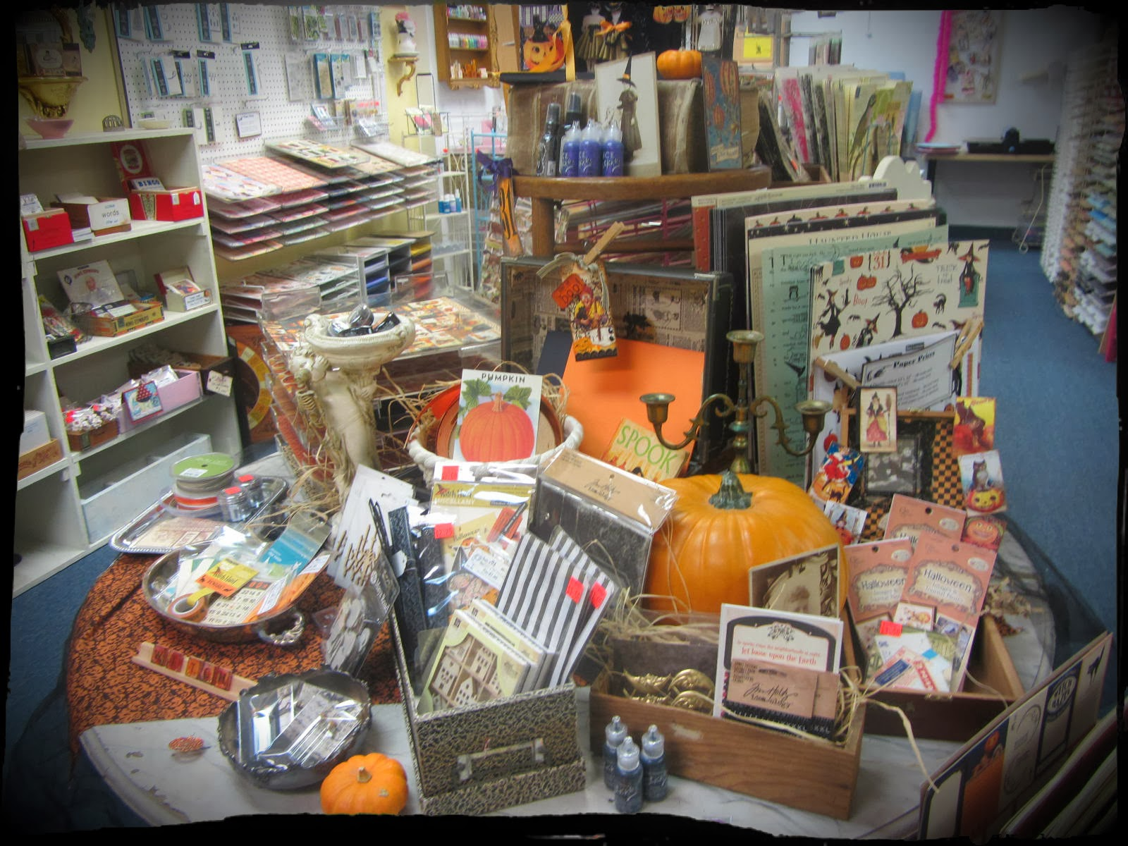 Scrapbook paper display - I Like To Use A Lot Of Vintage Items To Display Merchandise