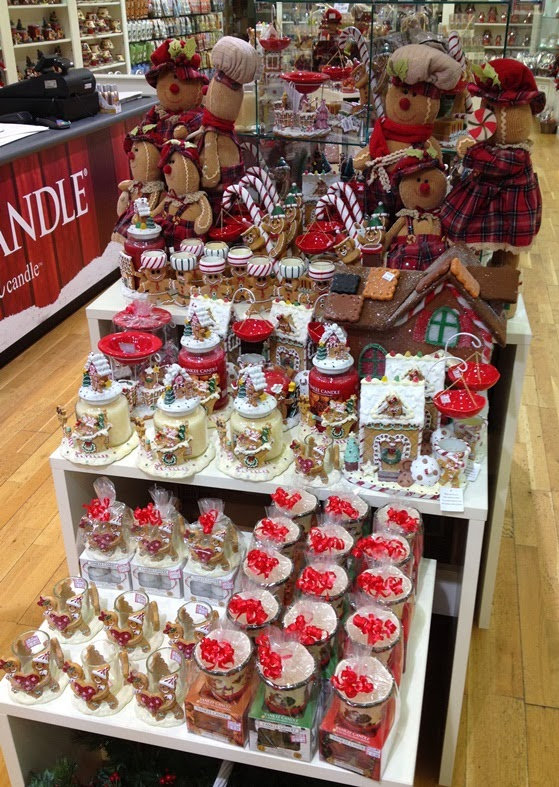 A lovely Gingerbread section with some novel display pieces \u2013 a Yankee  Candle handcart no less!