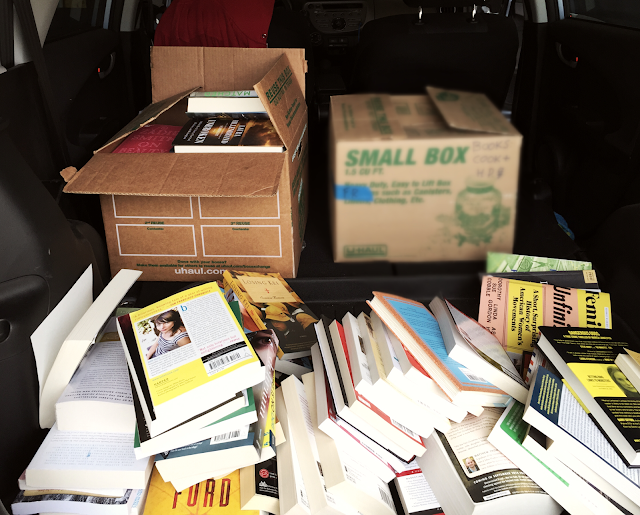 books and boxes loaded in the car book purge The 3 Rs Blog