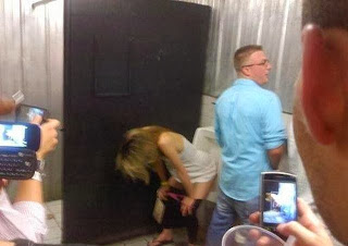 funny picture: woman pees in men's toilet