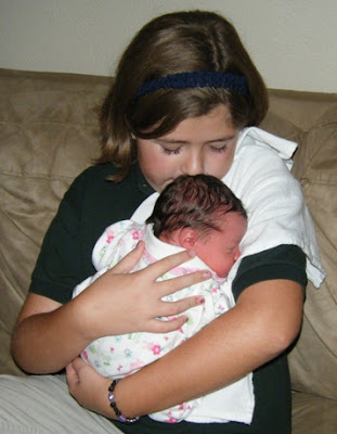 Tyler holding newborn Sasha