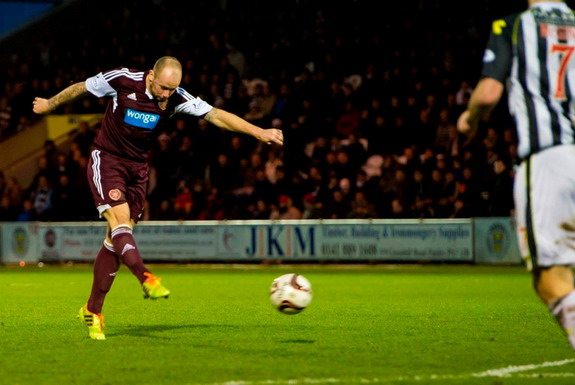 Hearts player Jamie Hamill shoots to score his team's equaliser against St Mirren