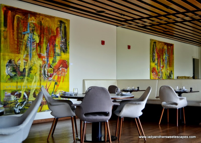 indoor seating and paintings at El Sur Dubai