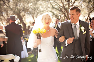 walking down the aisle with yellow roses
