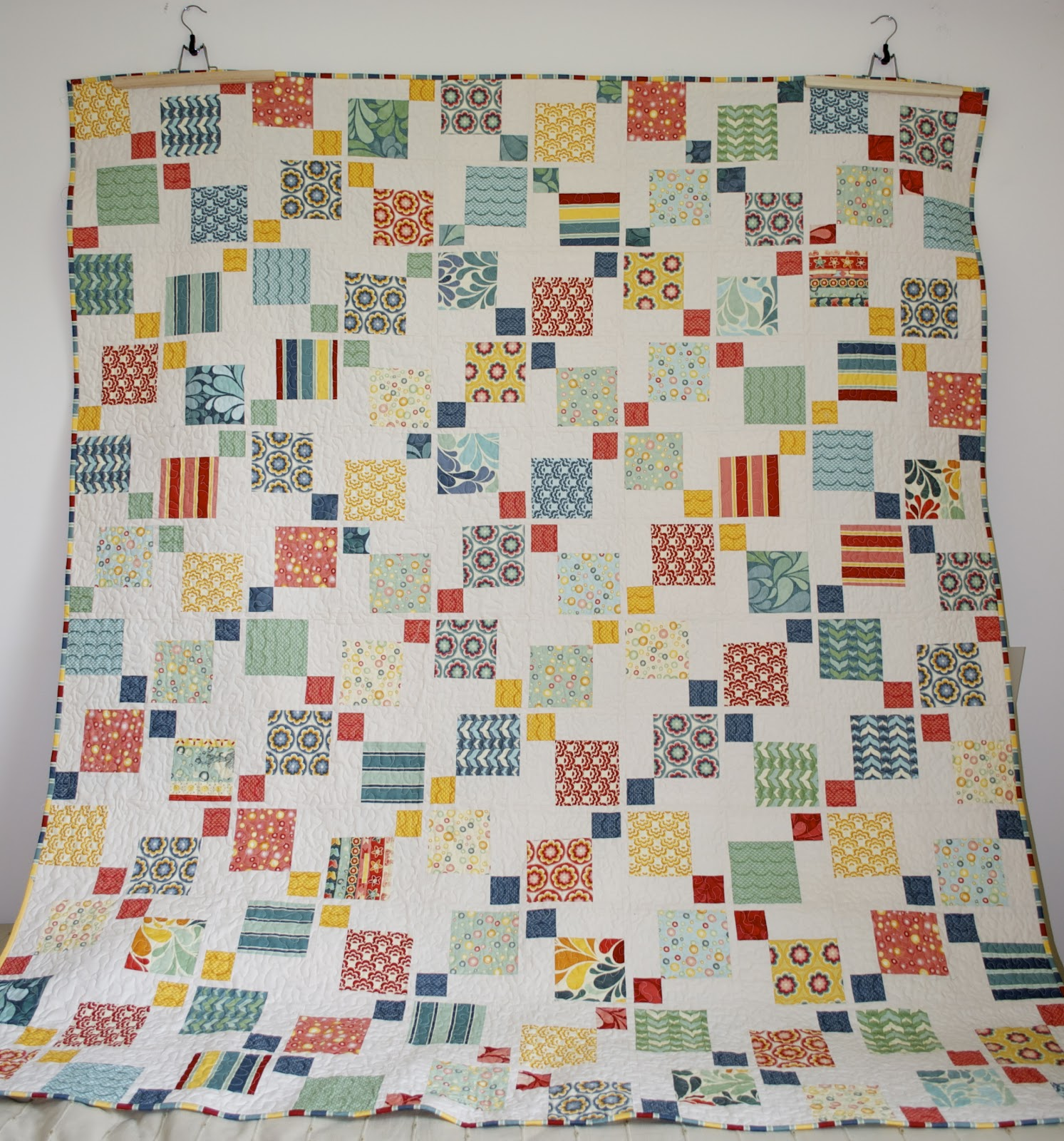 Disappearing 9 patch quilt with 3 colors