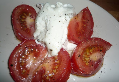 Burrata with tomatoes, olive oil and ground pepper