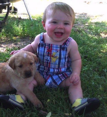 cute little baby Kid With Pet puppy picture to Download freely