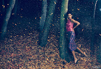 Rihanna strikes a pose in the forest