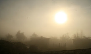 The sun slowly burning through the mist