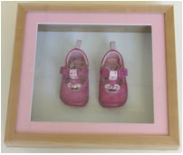 baby shoes in a frame