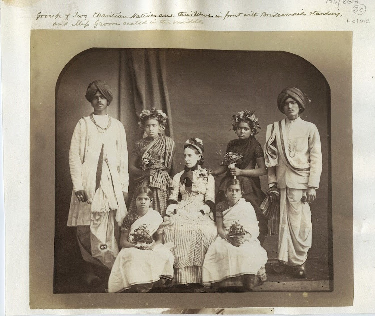 Group of two Christian Natives and their Wives in front with two Bridesmaid and an European Lady - c1870's