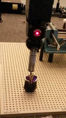CMM machine inspecting perfume bottle