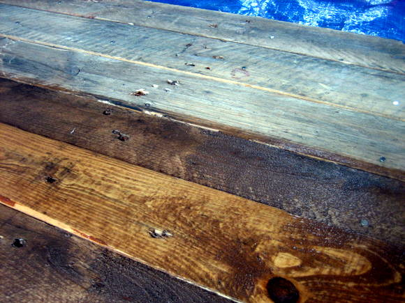 Here is a closer look at what our DIY pallet sign looked like half way through painting! I love this weathered look!