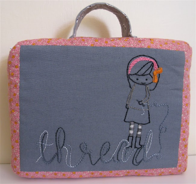 the word thread embroidered in loopy style with cartoon girl holding sewing needle