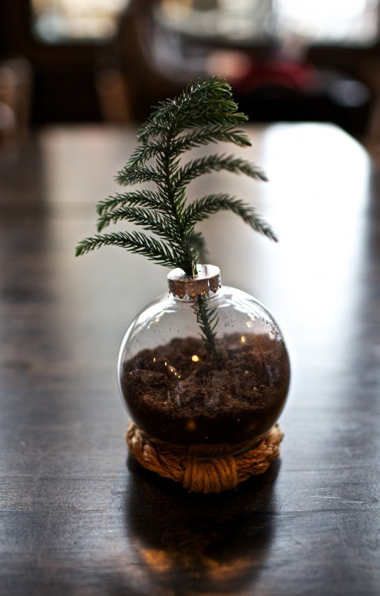 Christmas tree bruch placed inside a clear ornament ball as tabletop decoration. Mini tabletop Christmas tree diy by Gimme Some Style.