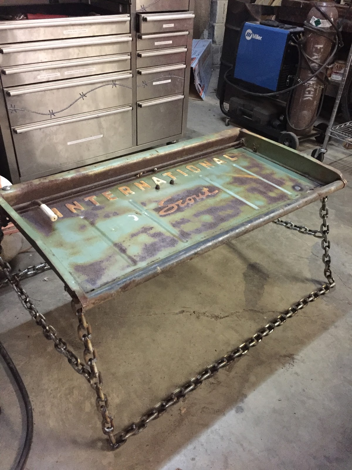 ... come up with a Christmas present for my older brother and deisel  mechanic, I decided to make a coffee table out of an old International  Scout tailgate. - Shenandoah Bicycle Company Blog: Welded Coffee Table By Dillon