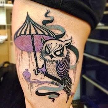 Tatuagens femininas de coruja na coxa - Fotos