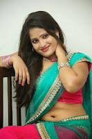 Anusha sizzling Pictures in half saree 069.JPG