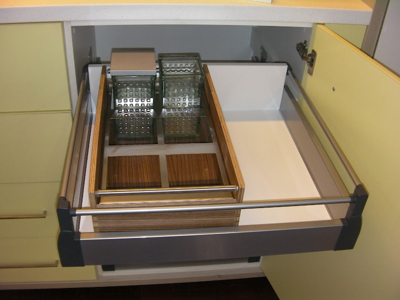 Kitchen drawers with all variations of dividers and utensil holders. title=