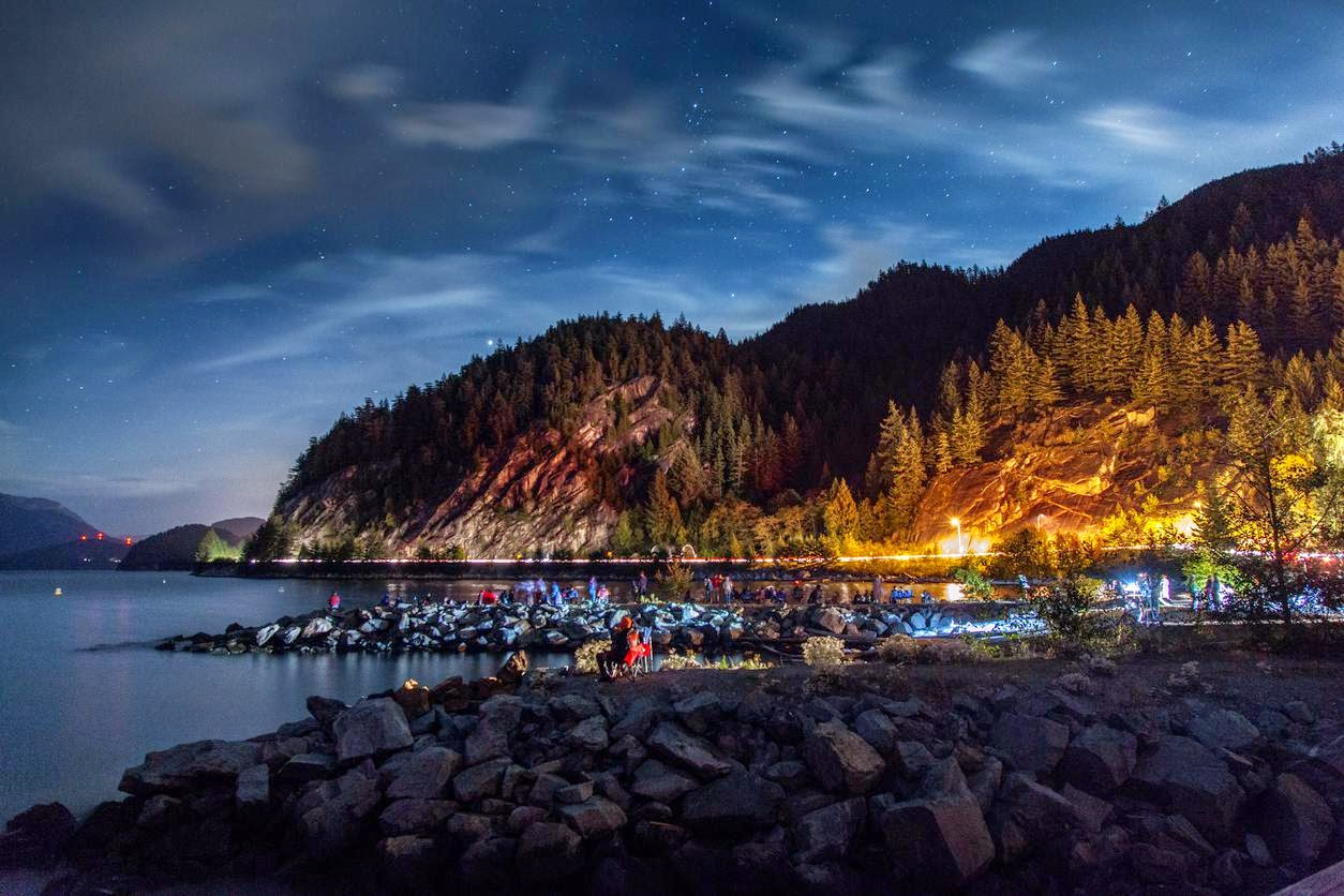 Visitors wait for a rare show of northern lights at Porteau Cove, outside Squamish. Credit Remy Scalza   A mountain town now more than a stopover.