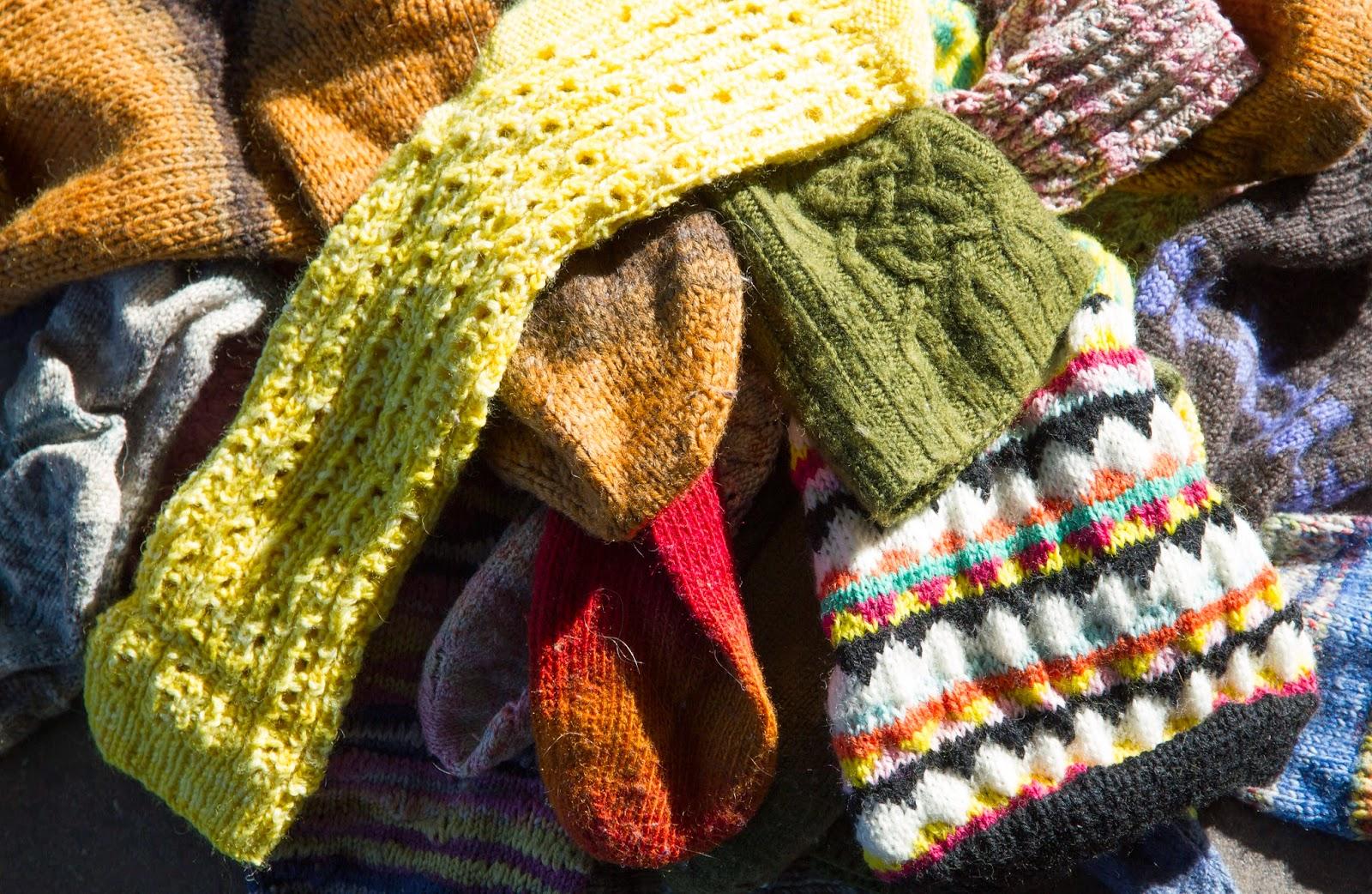 a pile of handknitted socks, www.bykaae.dk