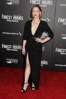 Holliday Grainger flaunt cleavage in the black floor-length dress at The Finest Hours Premiere red carpet dresses
