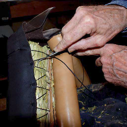 Detail of horse collar making